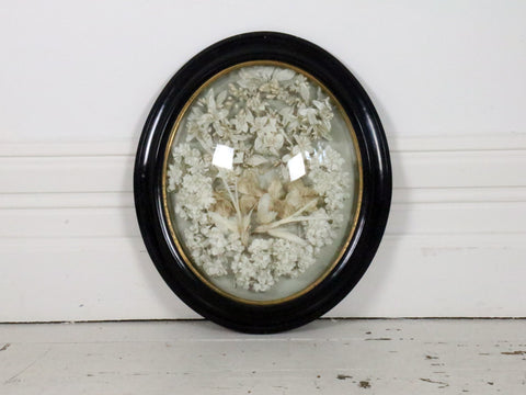 A Superb White bird & Flower Garland in Black Domed Frame