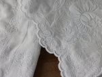 A pair of ornate French Cornely embroidered voile curtains