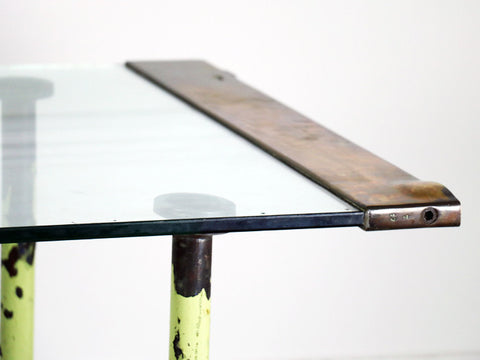 A glass, brass & steel table recycled from original Wedgwood factory