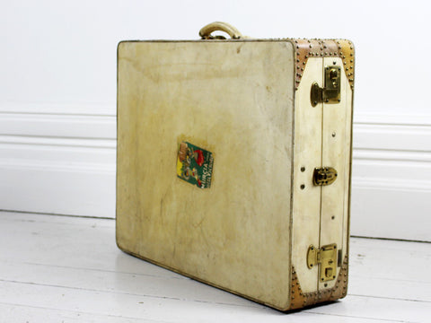 A Vellum Suitcase with Interior Hanging & Wing Shaped Handle Mounts