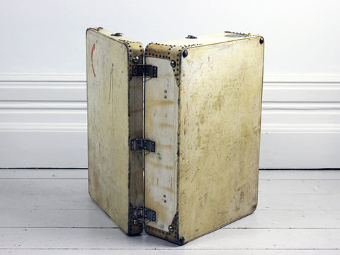 A 1940's Medium Vellum Suitcase with Studwork & Wing Shaped Handle Mounts