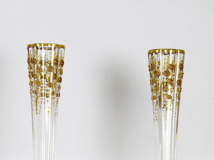 A pair of fluted antique French glass vases with gold flower decoration