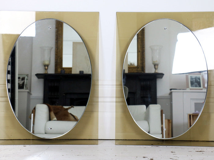 A pair of Caprotti Italian 1960's smoked and silver wall mirrors