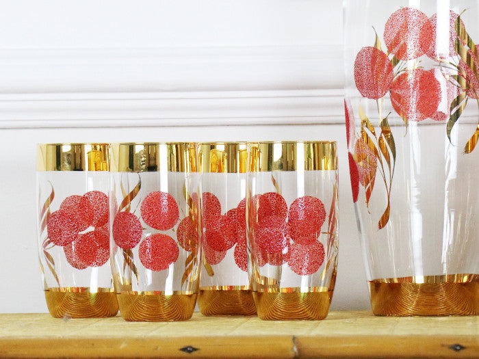 A set of 8 tumblers and matching jug with red & gold decoration