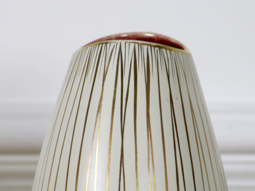 A vintage Handgemalt cream ceramic vase with gold stripes & red interior