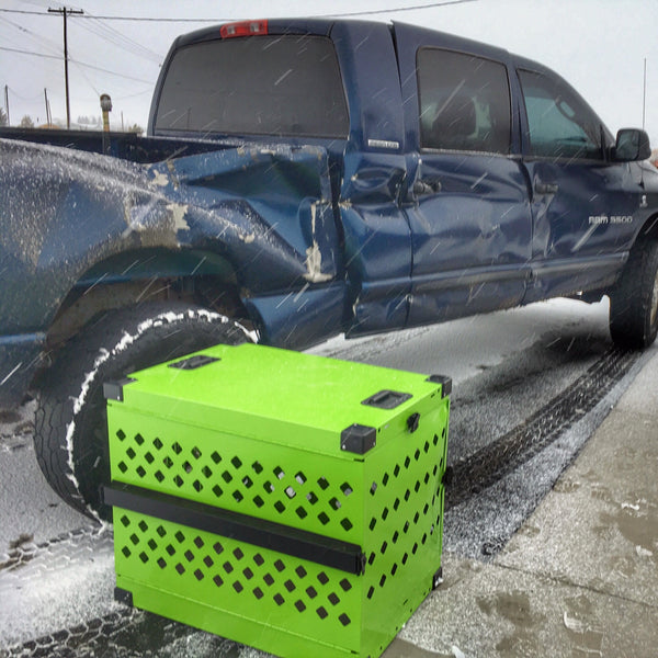 green collapsible impact dog crate involved in car crash