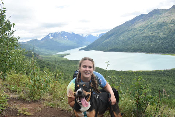 dog and girl hiking