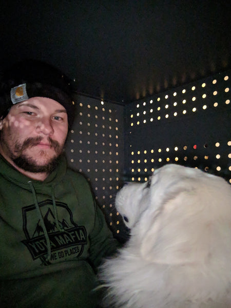 guy and great pyrenees dog in impact dog crate