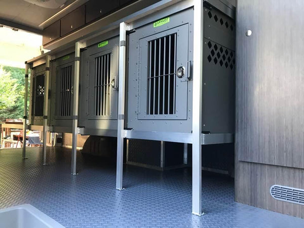 gray stationary impact dog crates in custom van