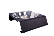 angle view of single aluminum black dog bowl stand with stainless steel bowl from impact dog crates