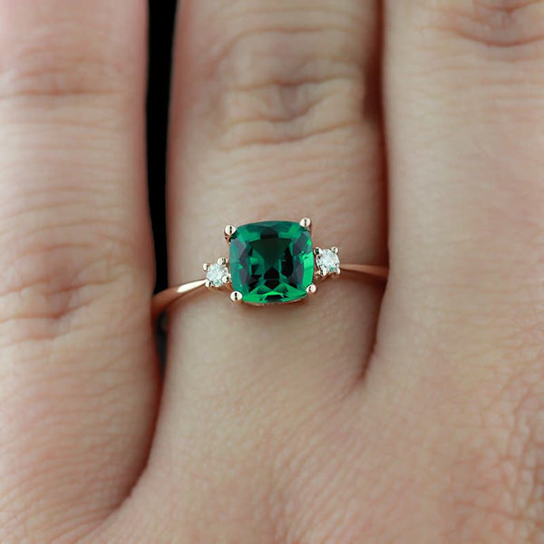 Custom MiaDonna three stone engagement ring emerald