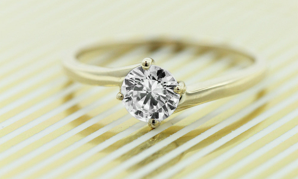 Delta Solitaire Engagement Ring