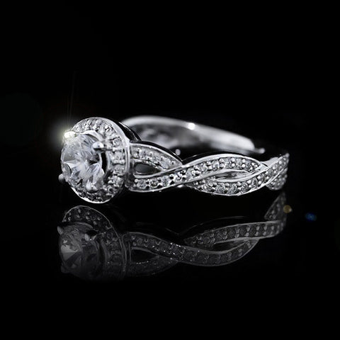 ∞ The Petals Engagement Ring ∞ Halo engagement ring with wrapping infinity shape band