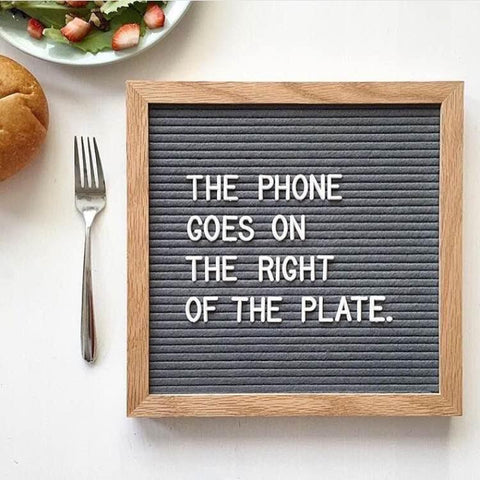 The phone goes on the right of the plate sign