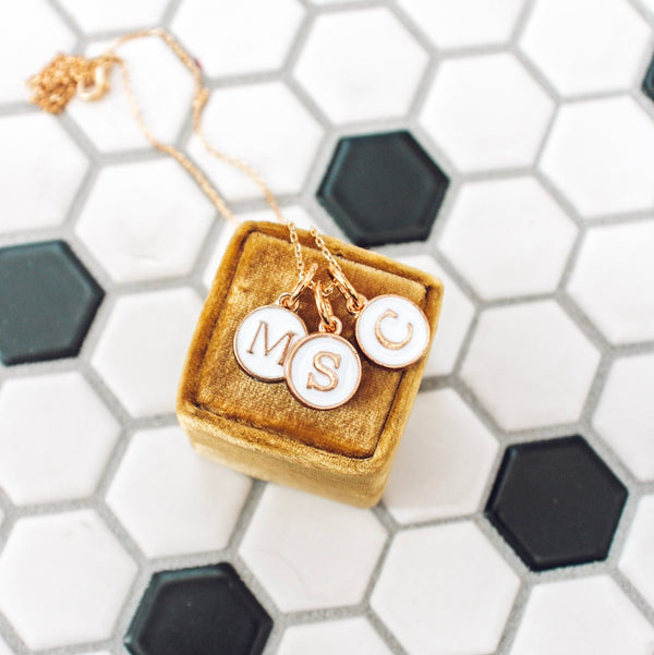 dainty gold and white initial charm necklace