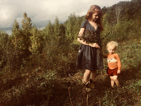 Mom and baby wildcrafting medicinal plants