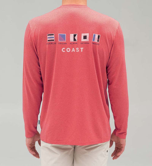 Model wearing Coast Apparel Coast Flag Long Sleeve Performance Tee watermelon heather back