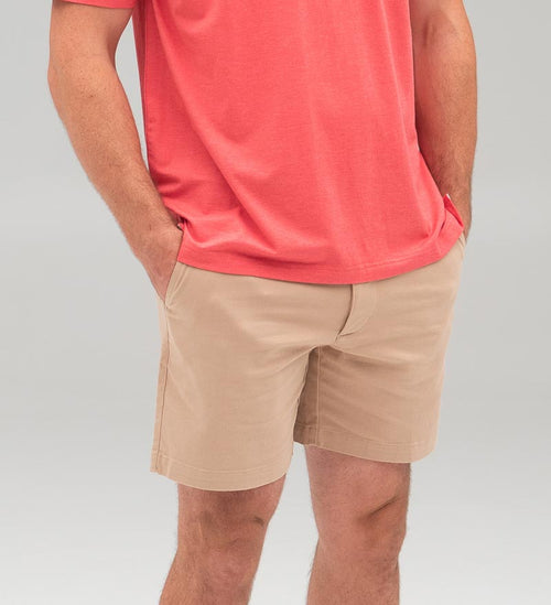 Model wearing Coast Apparel Dock Shorts dock front