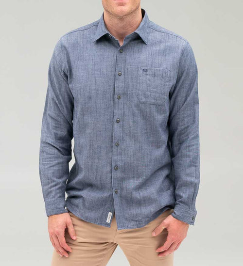 Model wearing Coast Apparel Bowman Button Down Shirt chambray front