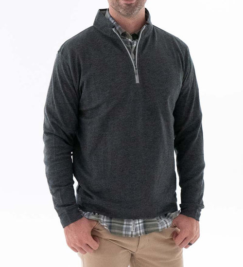 Model wearing Coast Apparel Beacon Heather Quarter Zip charcoal heather front