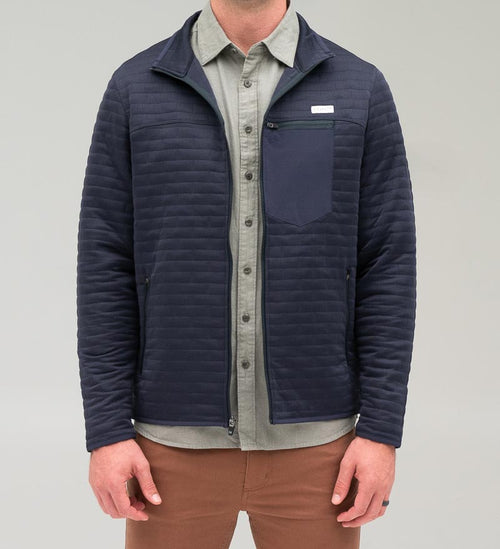 Model wearing Coast Apparel Foresail Quilted Jacket navy front