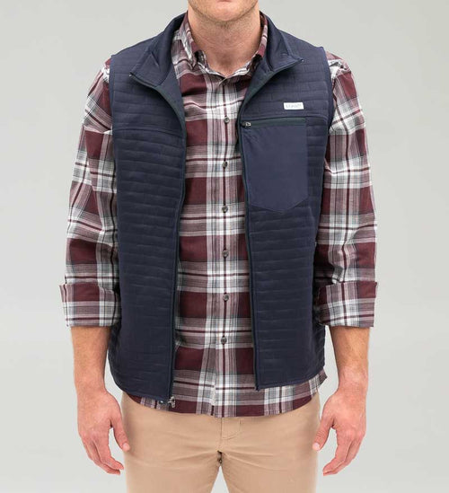 Model wearing Coast Apparel Foresail Quilted Vest navy front