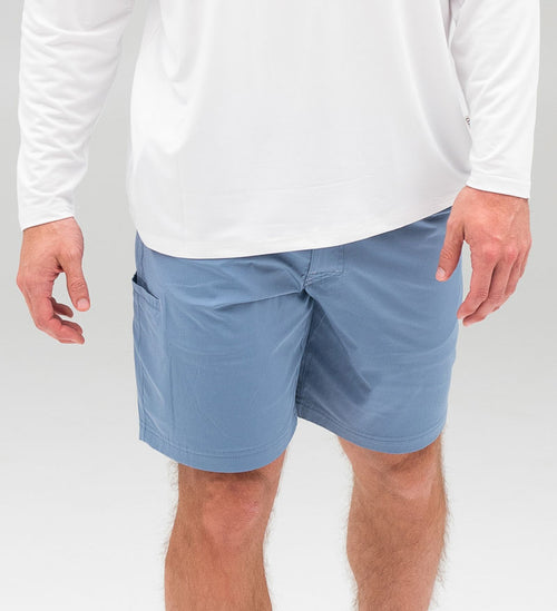Model wearing Coast Apparel Tech Shorts chambray front