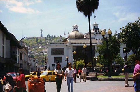 Old Quito Square. Our Lady of Quito is seen on top of the mountain on left.
