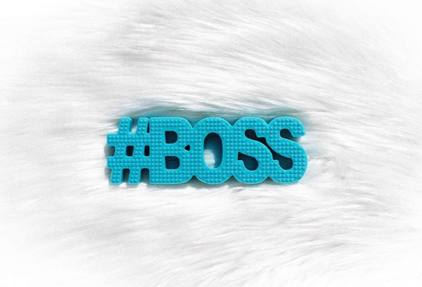 "Blue textured word teether, that is 2 x 6. It says, ""#BOSS."" It is solid and has is textured for baby gum relief. Freezer and dishwasher safe."