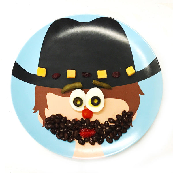 Adorable Sheriff and or Cowboy Food Face Plate. He is wearing a black cowboy hat and has brown hair.  He has no facial features so children can create them with food.  The sheriff is on a blue background melamine plate.