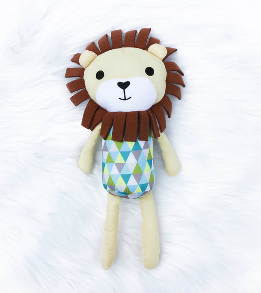 Tan soft twelve inch lion with argyle pattern on his stomach. Cream color face, legs and arms, brown mane. Embroidered black eyes, mouth, and heart-shaped nose.