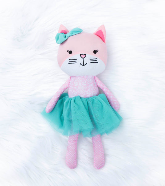 Pink soft twelve inch cat with blue tutu. The cat has embroidered eyes, mouth, and pink heart-shaped nose. It has pink and white damask pattern on its stomach. The cat has a white polka-dotted legs and arms. The cat has a blue bow on her head. She is made of polyester. Meet CoCo the Cat who is known for being clever, independent and rather smart. Our Loveys are such a cute gift for all ages.