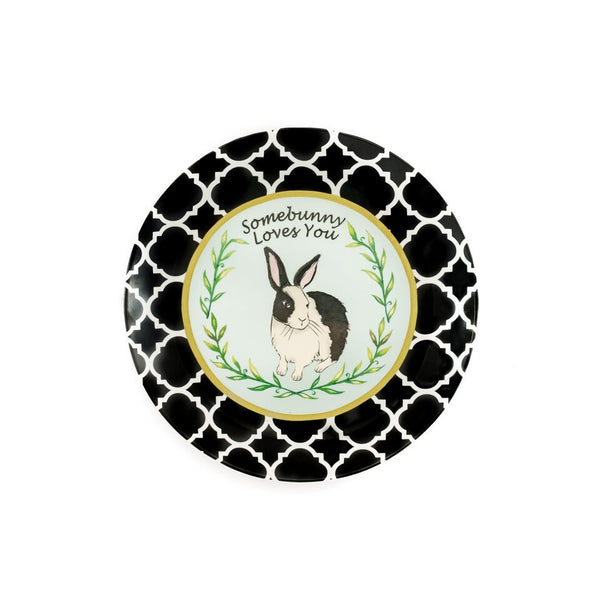 "Ceramic Bunny Plate illustrated with a black and white rabbit in the middle.  It has a light blue background and leaves going around the rabbit. It has a gold circle around the bunny and a black and white damask border.  At the top of the plate is says, ""Somebunny Loves You"""