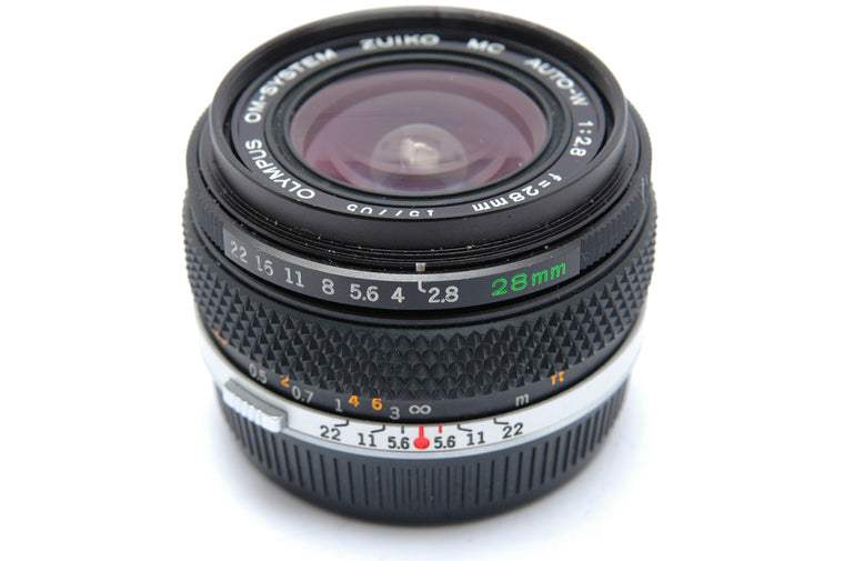 Used Olympus OM Zuiko Auto-W 28mm f/2.8  Manual Focus Lens