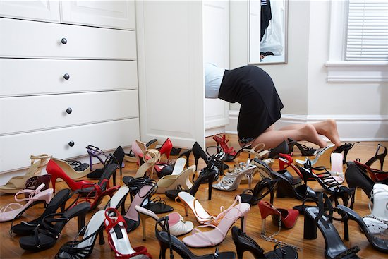 Woman looking in a shoe closet
