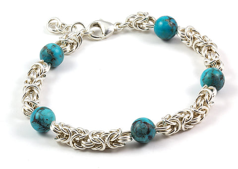 Sterling byzantine bracelet with Kingman turquoise beads. Invincible Art Jewelry.
