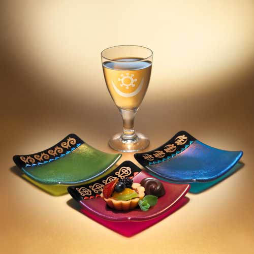 Small kiln formed glass plates and sandblasted wine glass by O'Neill Glass Art