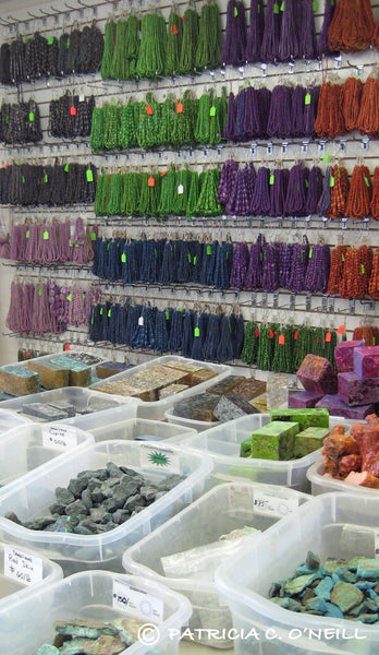 Strands of beads and rough stones at the Kingman mine store
