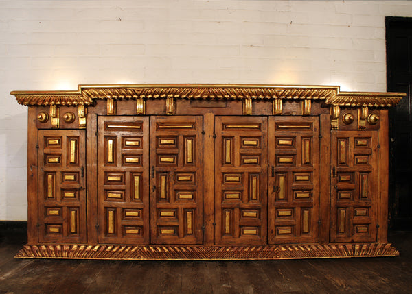 Sideboard reconstructed from reclaimed antique fragments and wood.