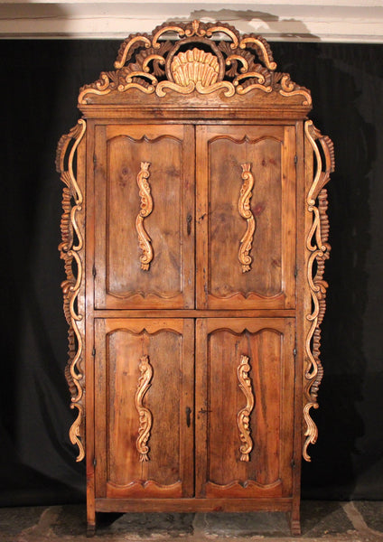 Armoire reconstructed from reclaimed antique heart pine