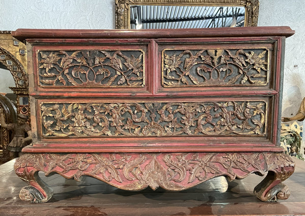 Red painted and gold leafed Chest with drawers from Indonesia.