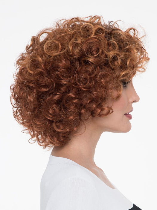 With a full head of bouncy curls, Kenya Wig by Envy has chin-length 'do gives you volume for days