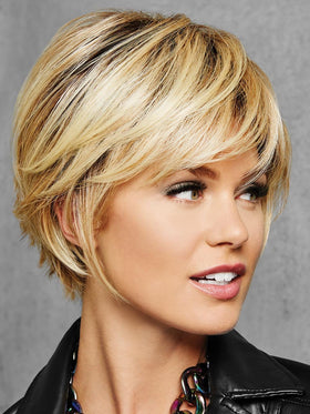 Full, side sweeping fringe and chin-length layered sides beautifully blend into textured layers at the nape for a no-fuss, contemporary silhouette