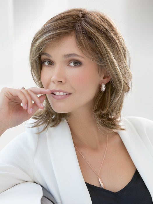 The beautiful cut and playful mid length bob makes this one of Ellen's highest reviewed designs
