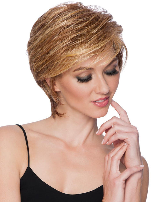 The SHORT TAPERED CROP Wig by Hairdo is a loosely layered, short cropped cut with generous volume in the crown that blends to a collar length nape