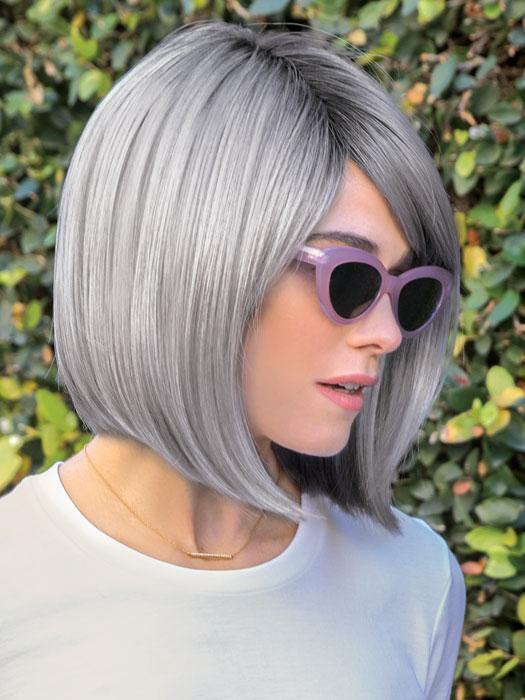 The Vada Wig by Amore is a sleek bob framing the chin featuring a natural side swept fringe