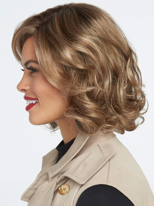 "This style can be worn in a ""scrunched"" manner or brushed out to create a more voluminous and stylized look."