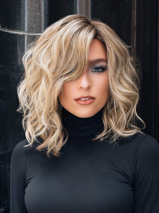 Jon Renau Mila has barely tamed open waves to create a look that combines power and playfulness in this long style.