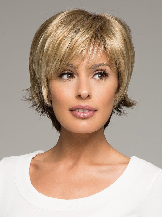 This short wig features a full bang and subtle, but spunky, flared tips at the nape.