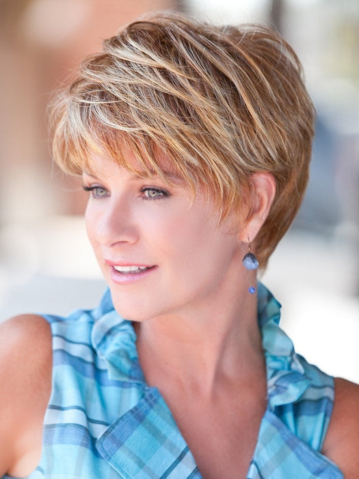Short and natural classic hair style with subtle layering and tapered edges